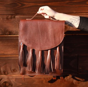 'SKYLARK'  brown leather backpack  with tassels